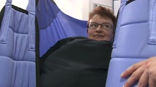 Peterborough City Hospital staff member tries bariatric suit