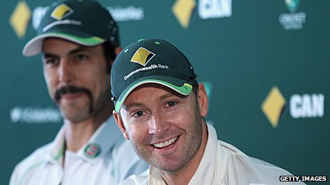 Michael Clarke with Mitchell Johnson in the background