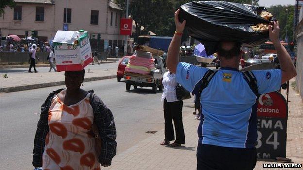 People carrying goods in Ghana