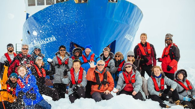 Passengers beside the MV Akademik Shokalskiy, which is currently trapped in ice in the Antarctic