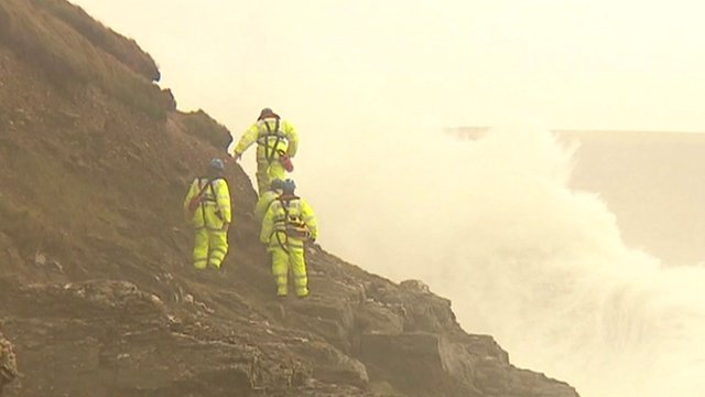 Rescuers on cliff face