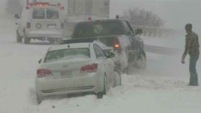 Cars struggling through snow
