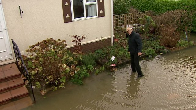 Patrick Pope outside his flooded home