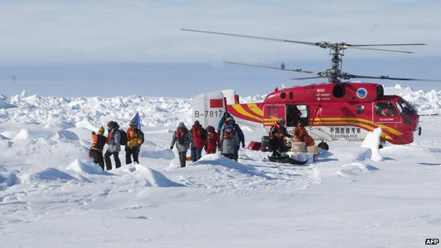 Passengers from the Akademik Shokalskiy in Antarctica disembark from a rescue helicopter from the Chinese ship Xue Long