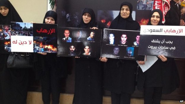 Lebanese women hold placards of victims of the Iran embassy bombing, Beirut, 3 Jan