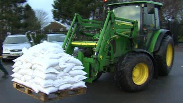 Tractor carrying sandbags
