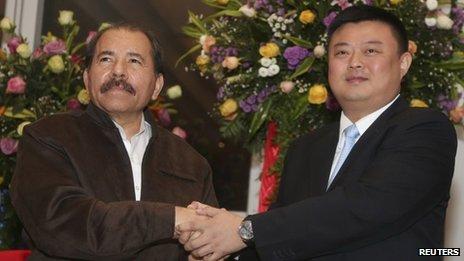 Daniel Ortega (left) and Wang Jing
