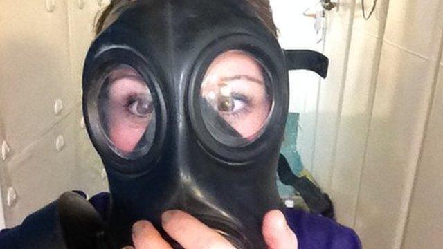 Anna Holligan tries on a gas mask