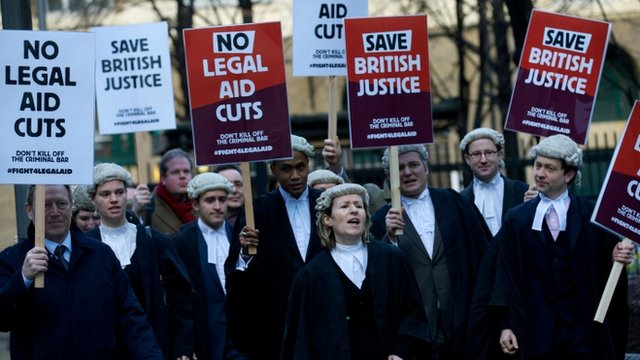 Legal professionals protest against cuts to the legal aid budget outside Southwark Crown Court in London