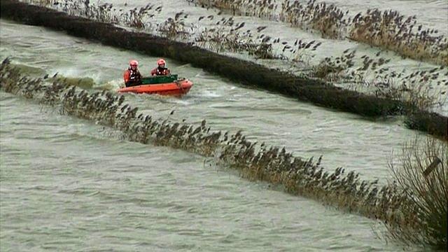 Boat heads for the village of Muchelney