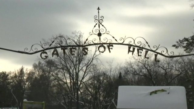 "Sign saying ""Gates of Hell"" in town of Hell, Michigan"