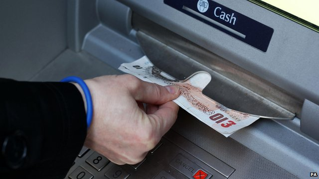 Person taking money out of a cash machine