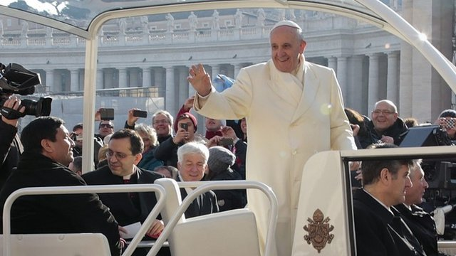 Fabian Baez, a priest from a church in downtown Buenos Aires, sits in the popemobile