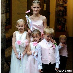 Thomas and family at a wedding