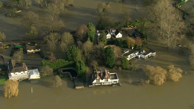 Houses surrounded by flood water in the Thames Valley region