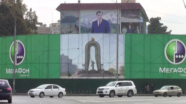 A street in Dushanbe with a billboard of President Rakhmon in the background