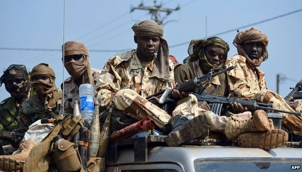 Chadian troops of the African-led International Support Mission to the Central African Republic (MISCA) patrol Bangui following the resignation of the president