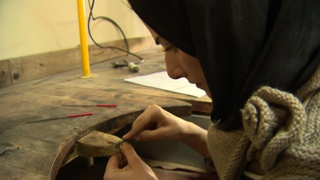 A girl makes jewellery in Kabul's old city