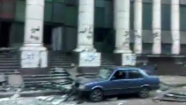 Debris and car with blown-out windows in Cairo