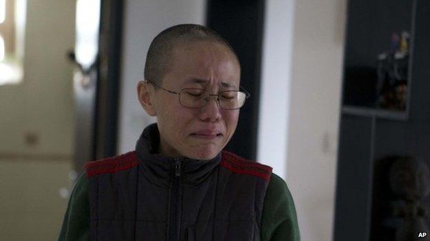 File photo of Liu Xia, wife of 2010 Nobel Peace Prize winner Liu Xiaobo, at her home in Beijing, China