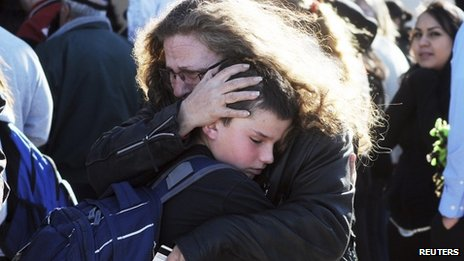 Students are reunited with family following a shooting at Berrendo Middle School 14 January 2014