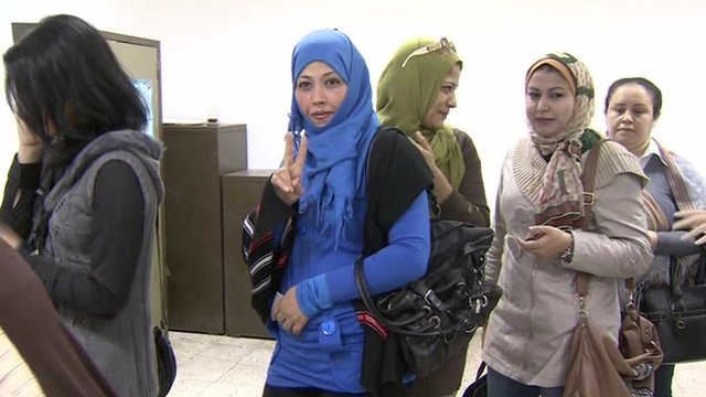 Women queue to vote inside a polling station