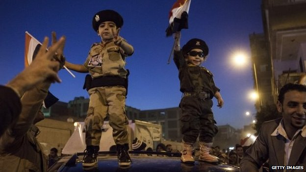 Supporters of army chief Gen Abdel Fattah al-Sisi celebrate at the end of the second day of voting in Egypt's constitutional referendum in the Shubra district, Cairo, on Wednesday