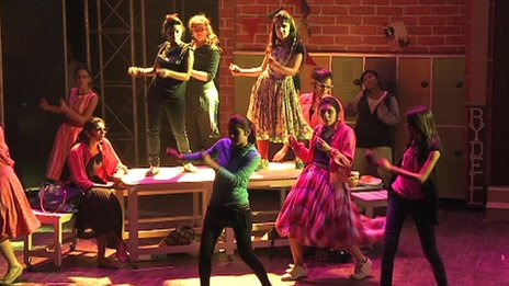 The cast of Made For The Stage Productions performance of Grease rehearse in Karachi