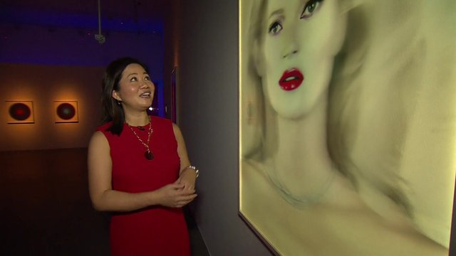 Linda Yueh and painting of Kate Moss