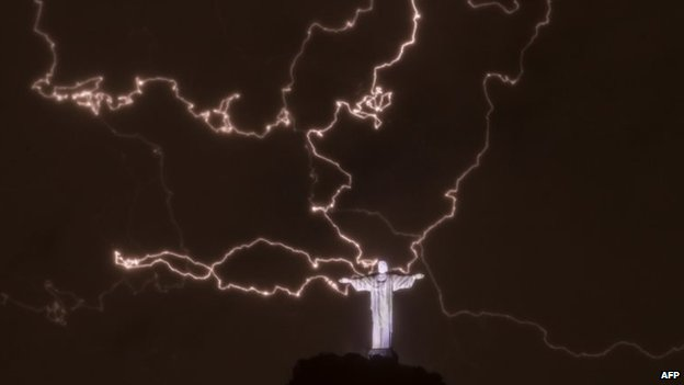 The Christ the Redeemer statue surrounded by lightning