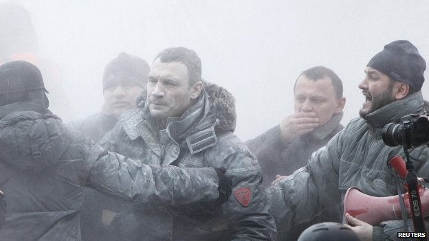 Vitaly Klitschko (centre) reacts after he was sprayed with a powder fire extinguisher during a pro-European integration rally in Kiev 19/01/2104