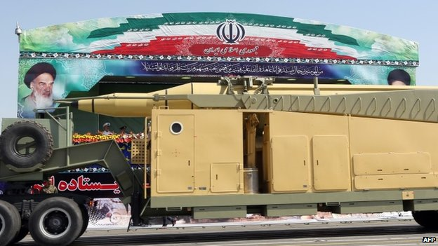 An Iranian Sejil ballistic missile is moved through Tehran during a military parade (22 September 2013)