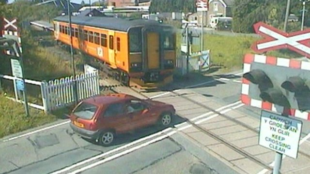 Near miss between car and train on level crossing