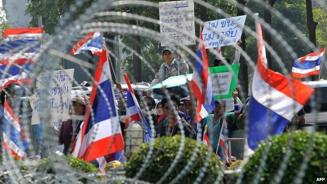 Anti-government protesters wave national flags