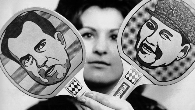 Faces of Nixon and Mao on ping pong paddles