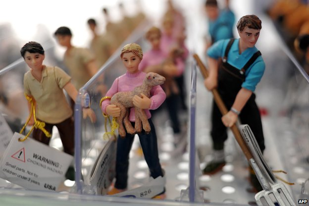 Toy farm workers are displayed at the London Toy Fair in Olympia, central London in 2013
