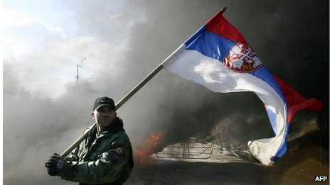 A Serbian protester waves the Serbian flag at Merdare border point between Kosovo and Serbia, a neutral zone 40 km from Pristina, on 21 February 2008