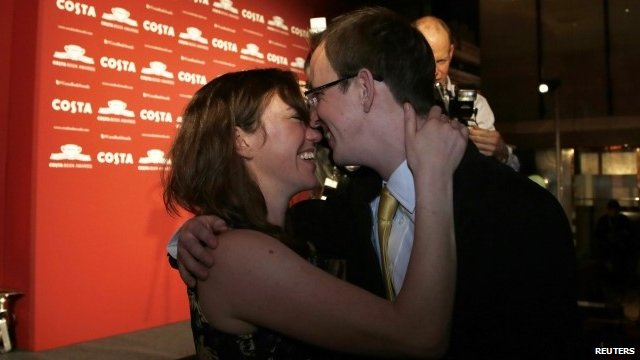 Nathan Filer is congratulated by his wife Emily after winning the Costa Book Award