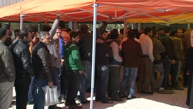 Refugees queue in Beirut