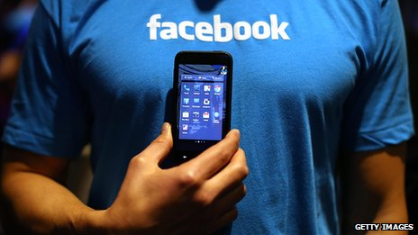 Phone in front of Facebook t-shirt