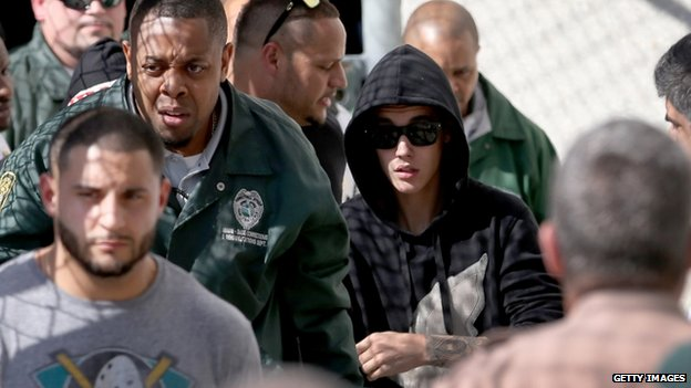 Justin Bieber (R) exits from the Turner Guilford Knight Correctional Center on January 23, 2014