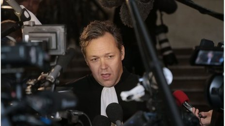 Lawyer Sylvain Cormier addresses journalists before the opening of the trial of his client Karim Benzema on 20 January 2014