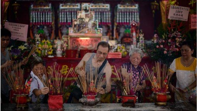 People burn incense sticks