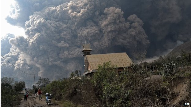 A giant cloud of hot volcanic ash clouds engulfs villages in Karo district during the eruption of Mount Sinabung volcano located in Sumatra on February 1