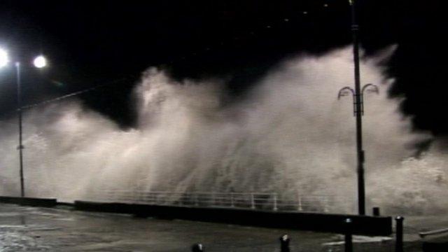 Waves crash on seafront of Aberystwyth