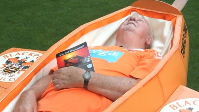 Malcolm Brocklehurst trying out his coffin