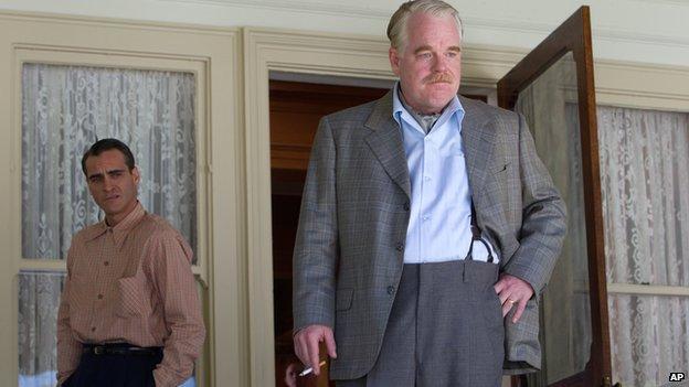 Philip Seymour Hoffman, alongside Joaquin Phoenix, in The Master