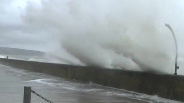 Waves breach sea wall