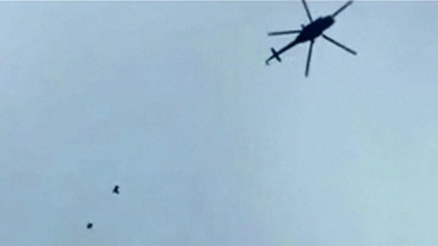 Still from unverified footage appears to show helicopter dropping bombs over Darayya