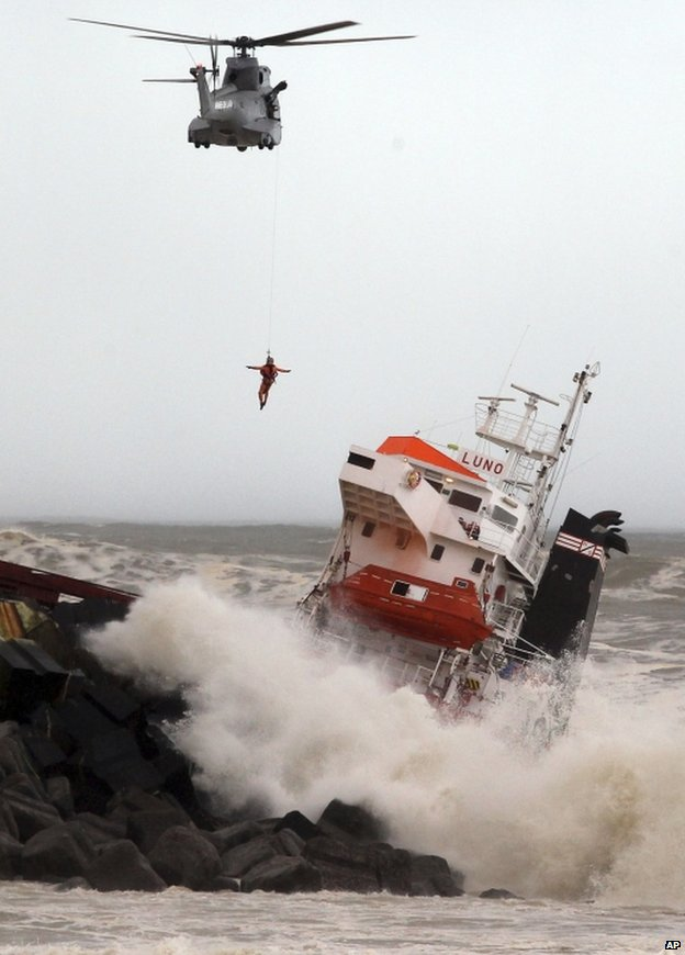 A helicopter with a man on a winch hovers near the stricken Luno, at Anglet on the French Atlantic coast, 5 February